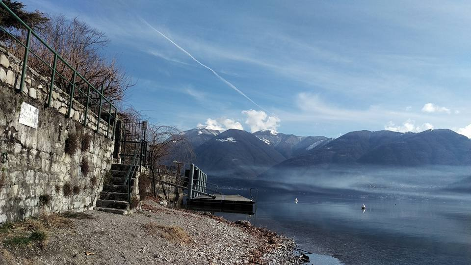 Lake Lugano in February with mist over the water